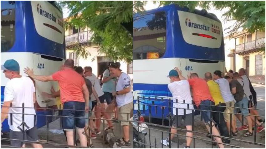 Turistas en Cuba obligados a empujar una guagua de turismo