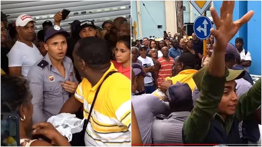 Cubano se enfrenta a la policía durante la reapertura del Mercado de Cuatro Caminos en La Habana el pasado fin de semana