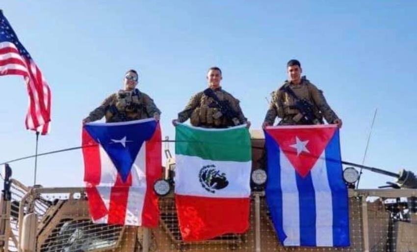 Soldados estadounidenses en Iraq orgullosos de sus raíces sacan sus banderas
