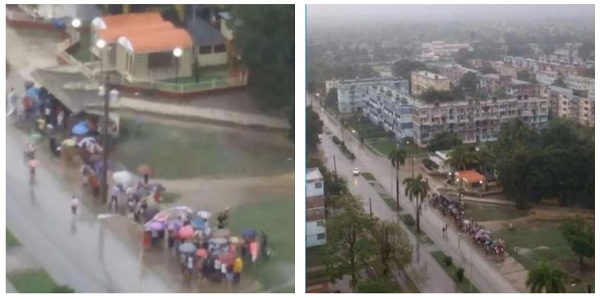 Cubanos debajo de la lluvia haciendo cola para comprar comida, en medio de la pandemia