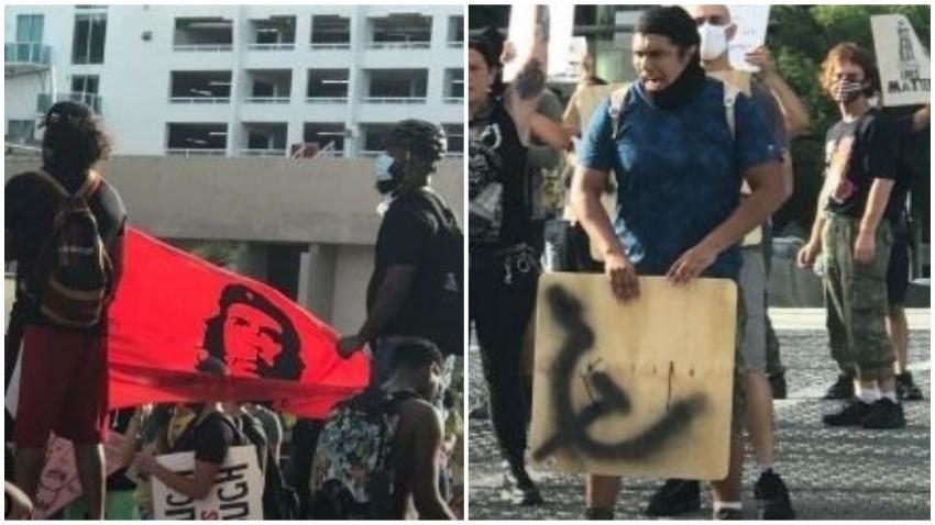 Manifestantes del pasado sábado en Miami llevaban una bandera del Ché Guevara y carteles con símbolos comunistas