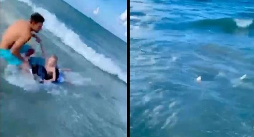 Oficial de la policía salva a un niño de un tiburón en una playa de Florida