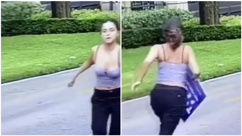 En cámara una mujer arranca un cartel de Donald Trump de afuera de una casa en el suroeste de Miami Dade