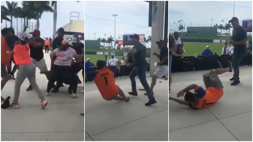 Mientras los policías quitaban carteles a los cubanos en el estadio en West Palm Beach un grupo de venezolanos se caía a golpes durante el juego